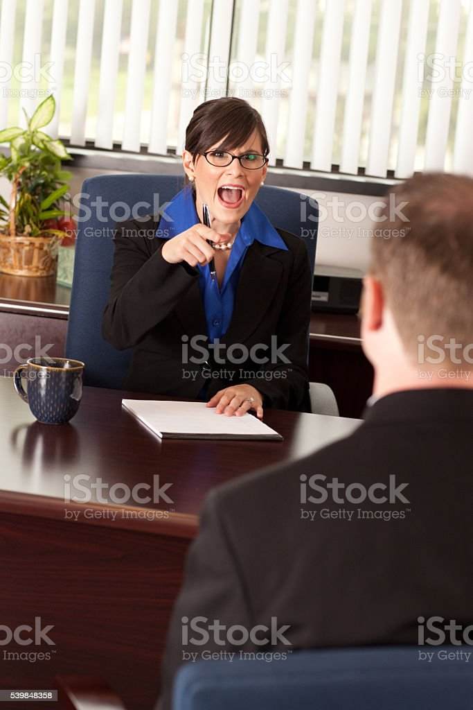 Young Businesswoman Yelling at a Businessman in Office stock photo