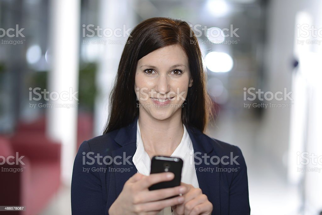 Young Businesswomen with smartphone stock photo
