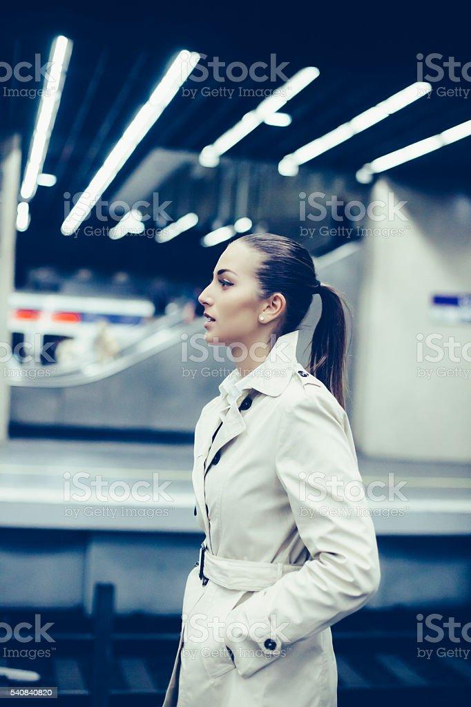 Young bussineswoman waiting on subway platform stock photo