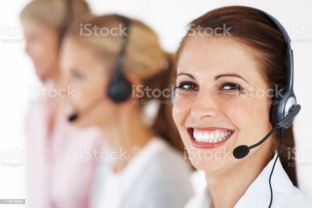 Young call center executive giving an attractive smile stock photo