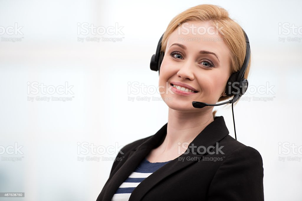 Young call center female operator with headphones stock photo