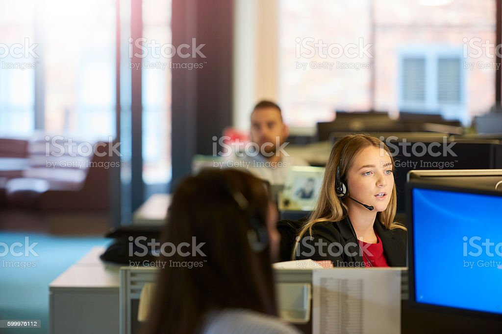 young call centre operative stock photo