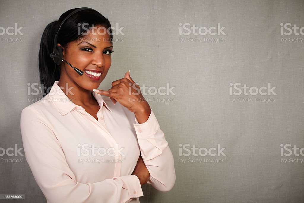Young callcenter operator smiling at the camera stock photo