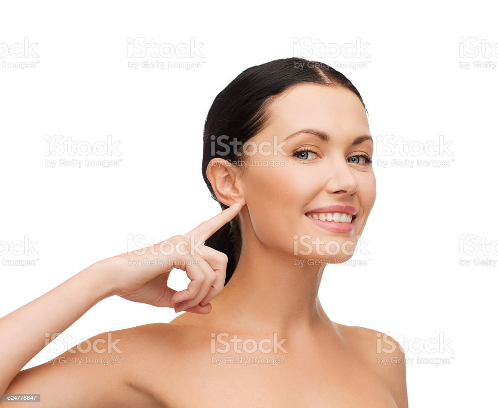 young calm woman pointing to her ear stock photo