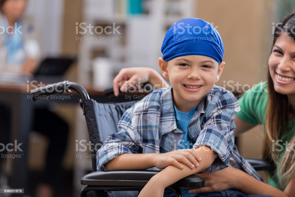 Young cancer patient with mom stock photo