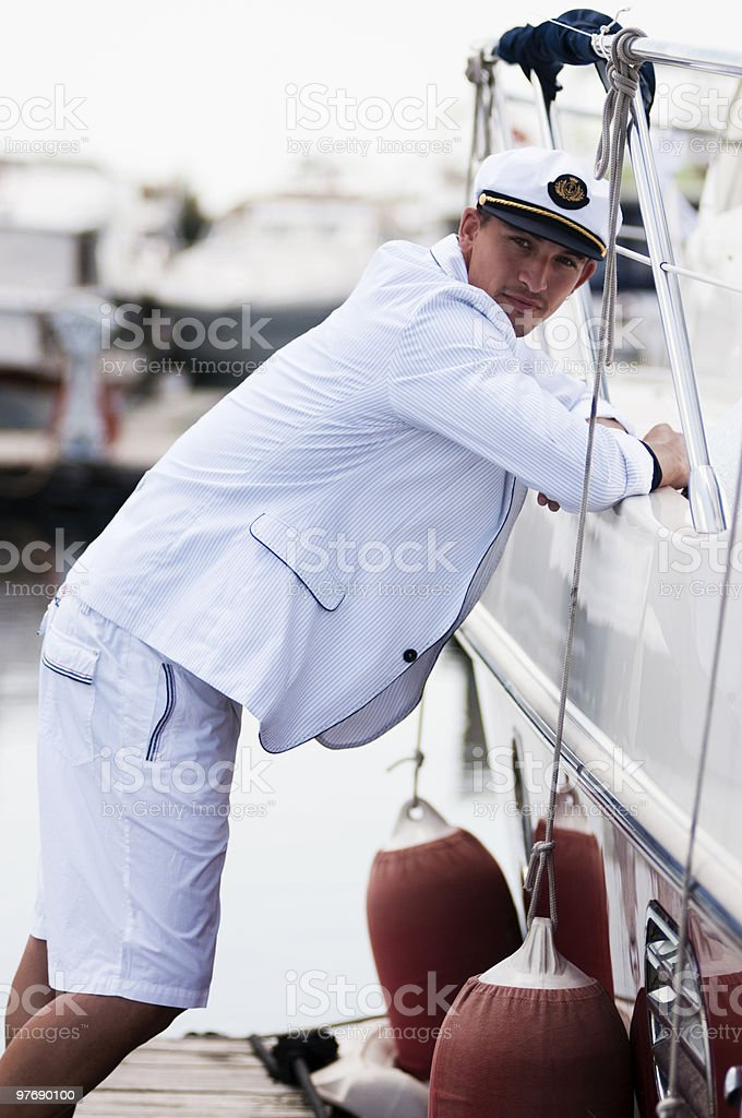 young captain lean to a cruiser royalty-free stock photo