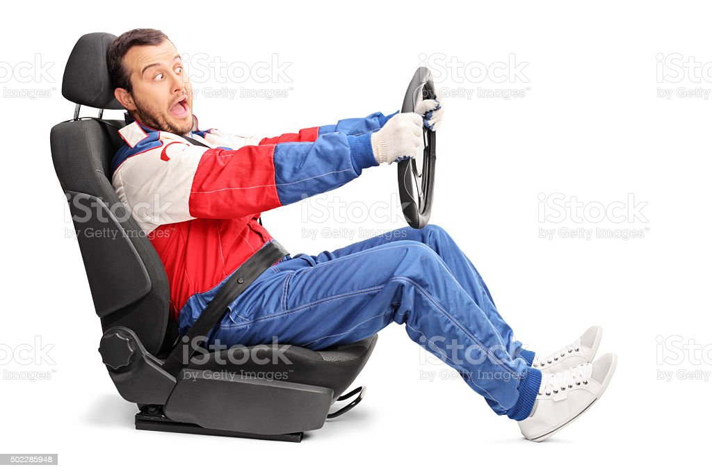 Young car racer driving very fast stock photo