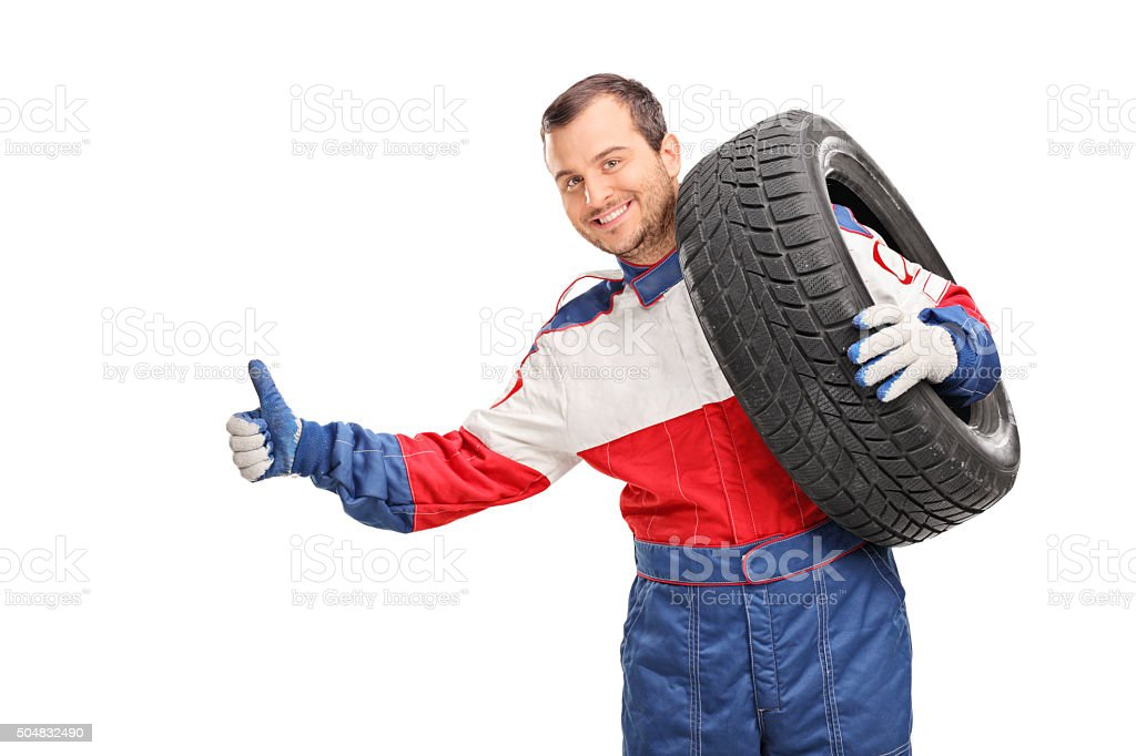 Young car racer hitchhiking stock photo