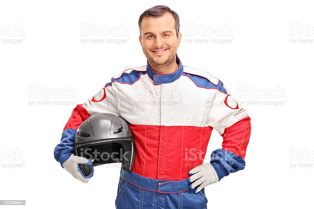Young car racer holding a gray helmet stock photo
