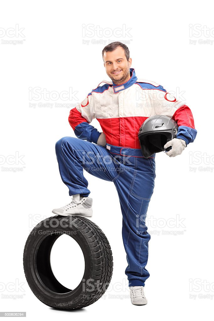 Young car racer holding a helmet stock photo