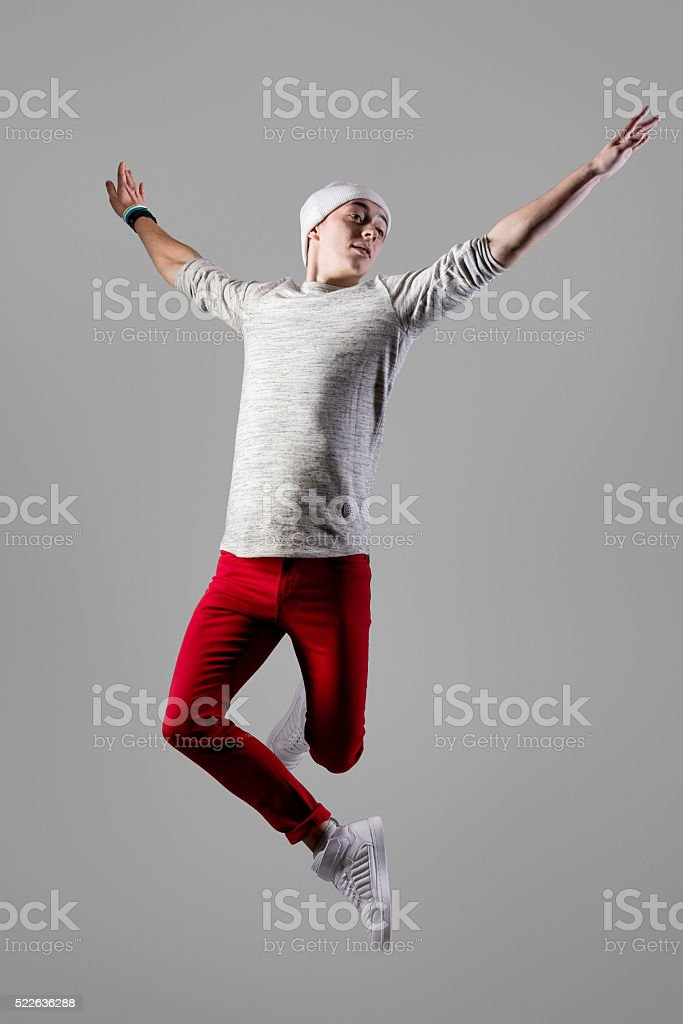 Young carefree man jumping stock photo