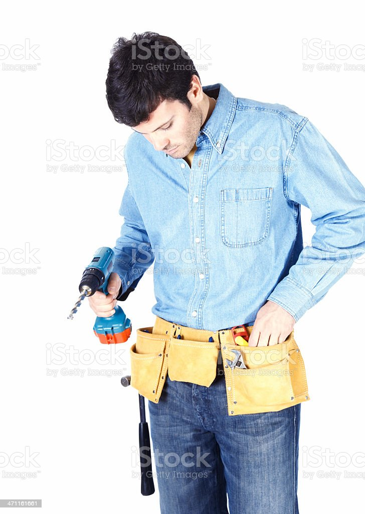 Young carpenter holding hand drill royalty-free stock photo
