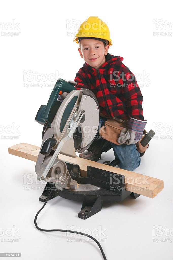 Young Carpenter Vertical Cut Wood royalty-free stock photo