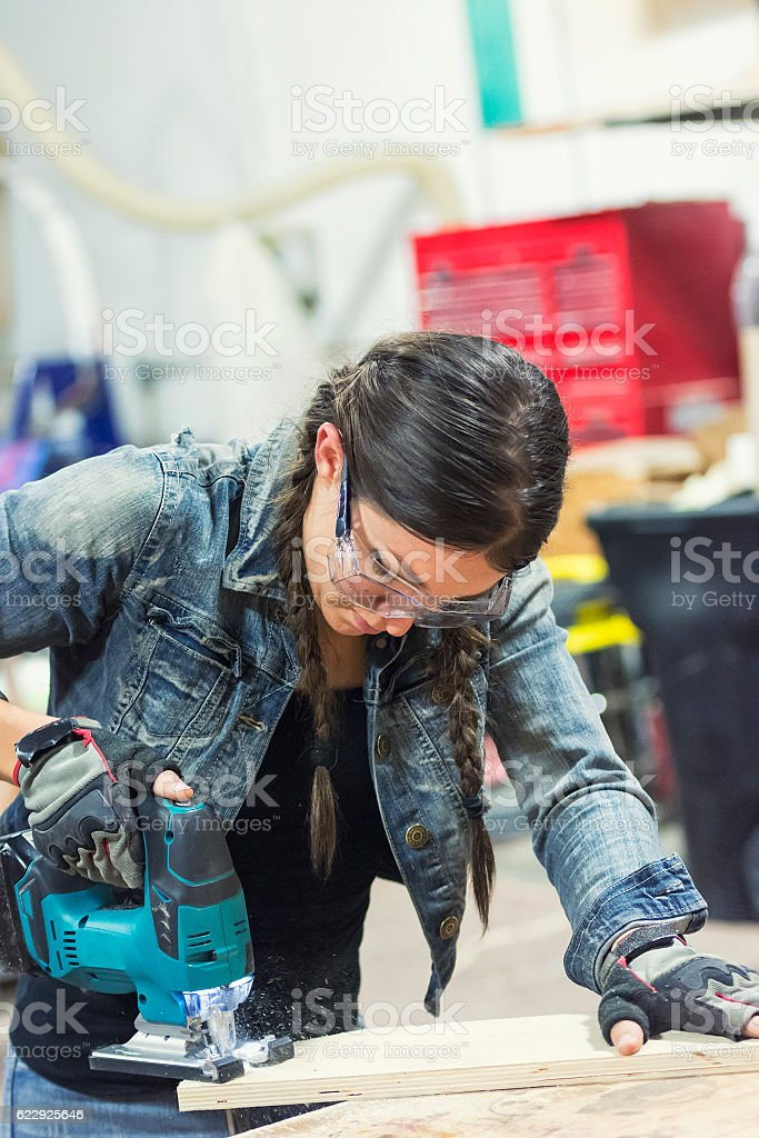 Young carpenter woman stock photo