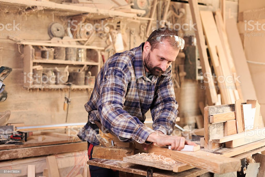 Young carpenter working in his workshop stock photo