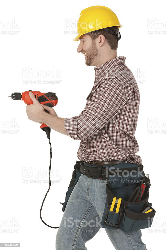 Young carpenter working with drilling machine royalty-free stock photo