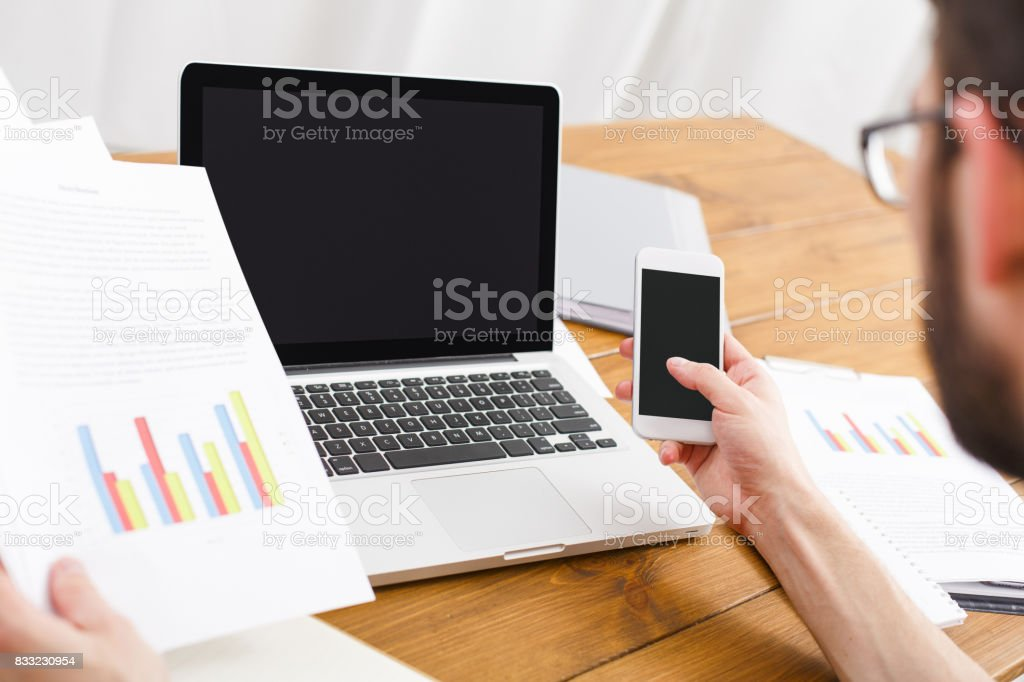 Young casual businessman in office, closeup stock photo