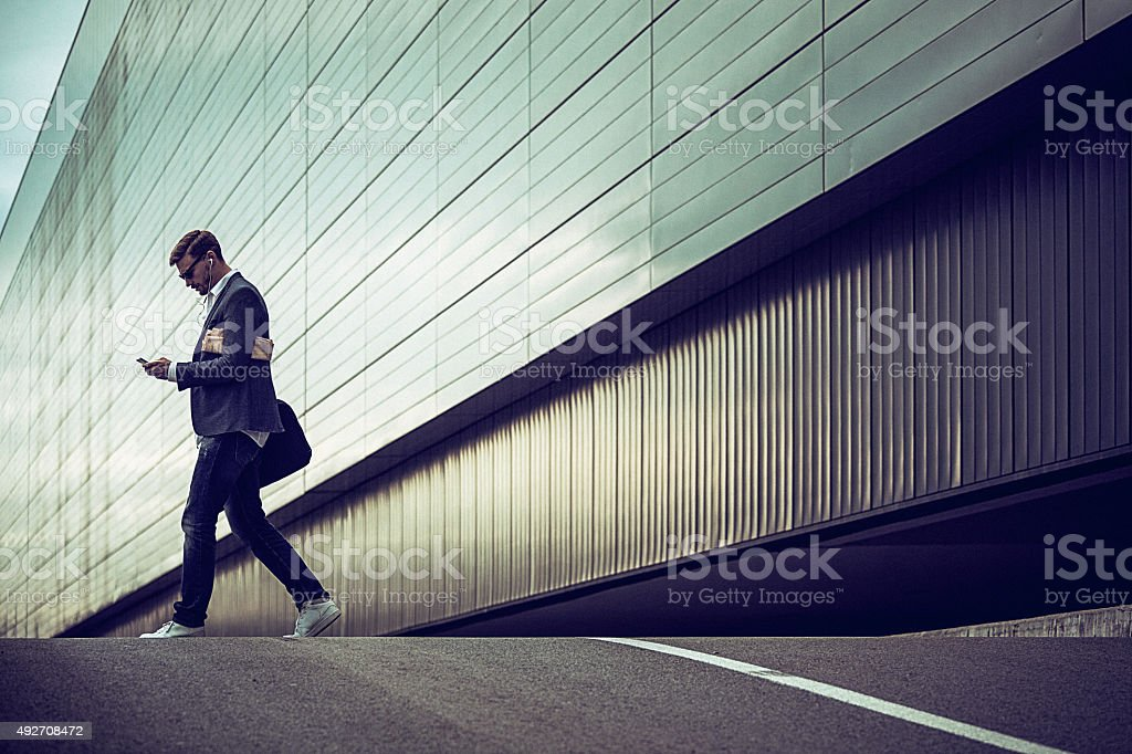 Young businessman using smartphone in the urban environment The man...