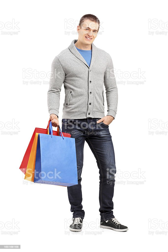 Young casual man holding shopping bags royalty-free stock photo