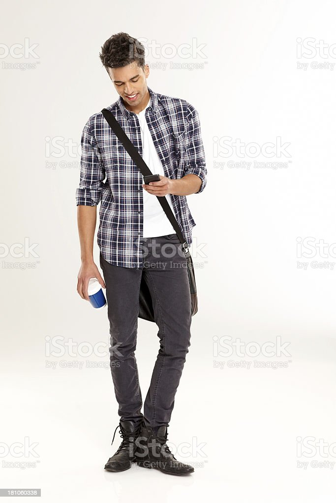 Young casual man texting on the phone royalty-free stock photo