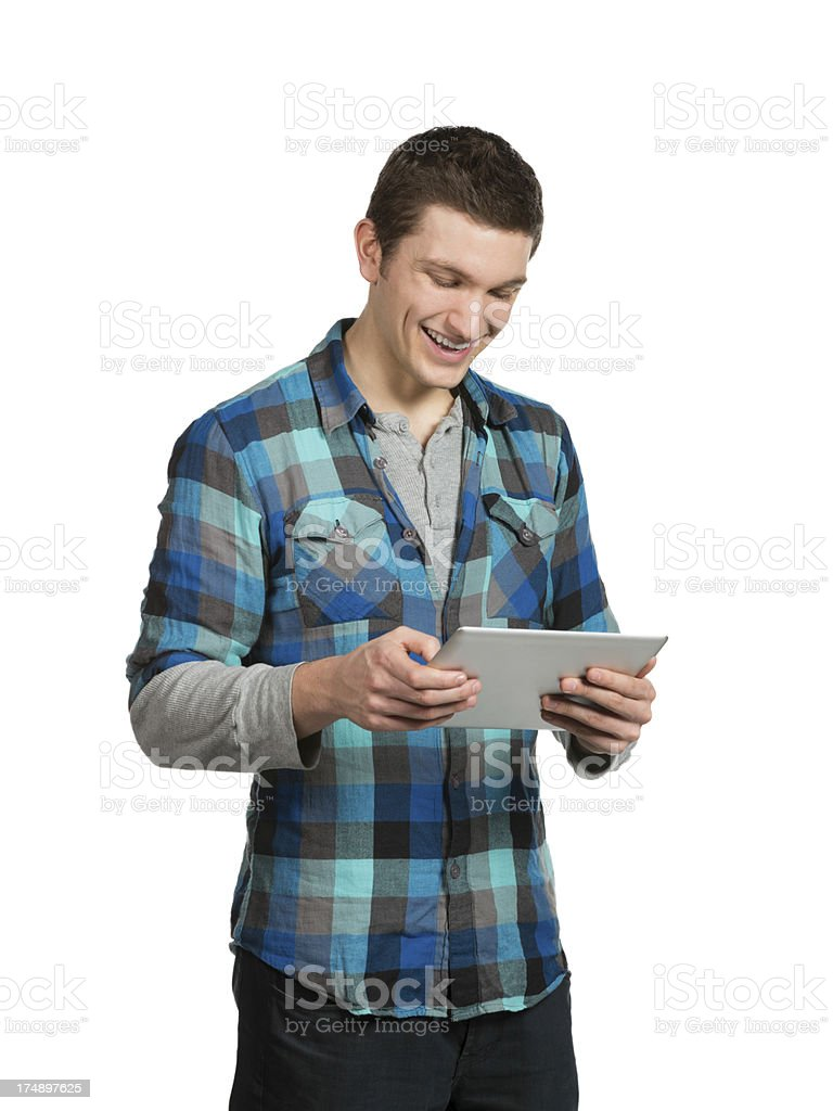 Young casual slacker student laughing at tablet royalty-free stock photo