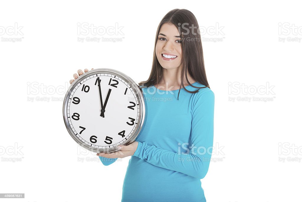 Young casual woman is holding a clock. stock photo
