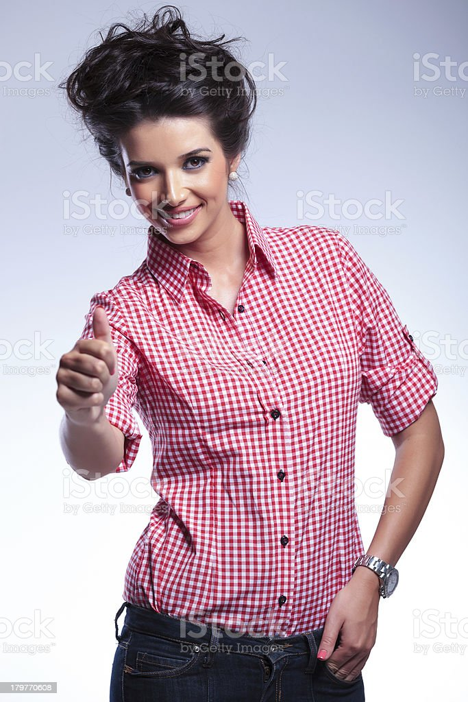 young casual woman making the thumbs up ok sign royalty-free stock photo