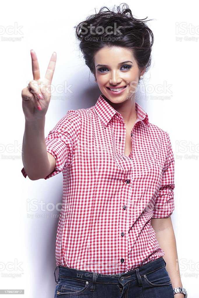 young casual woman making the victory sign royalty-free stock photo