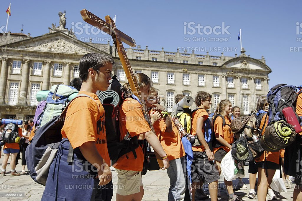 Young Catholic pilgrims on main city square in Santiago, Spain. stock photo