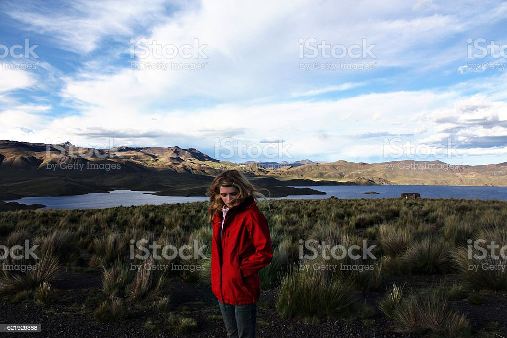 young caucasian blond smiling woman at cold landscape, Peru stock photo