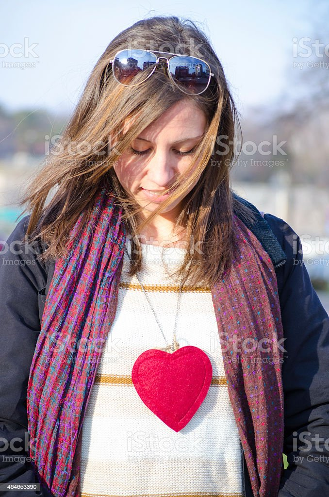 Young Caucasian brunette with a heart royalty-free stock photo