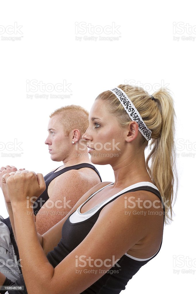 Young caucasian couple doing sit-ups royalty-free stock photo