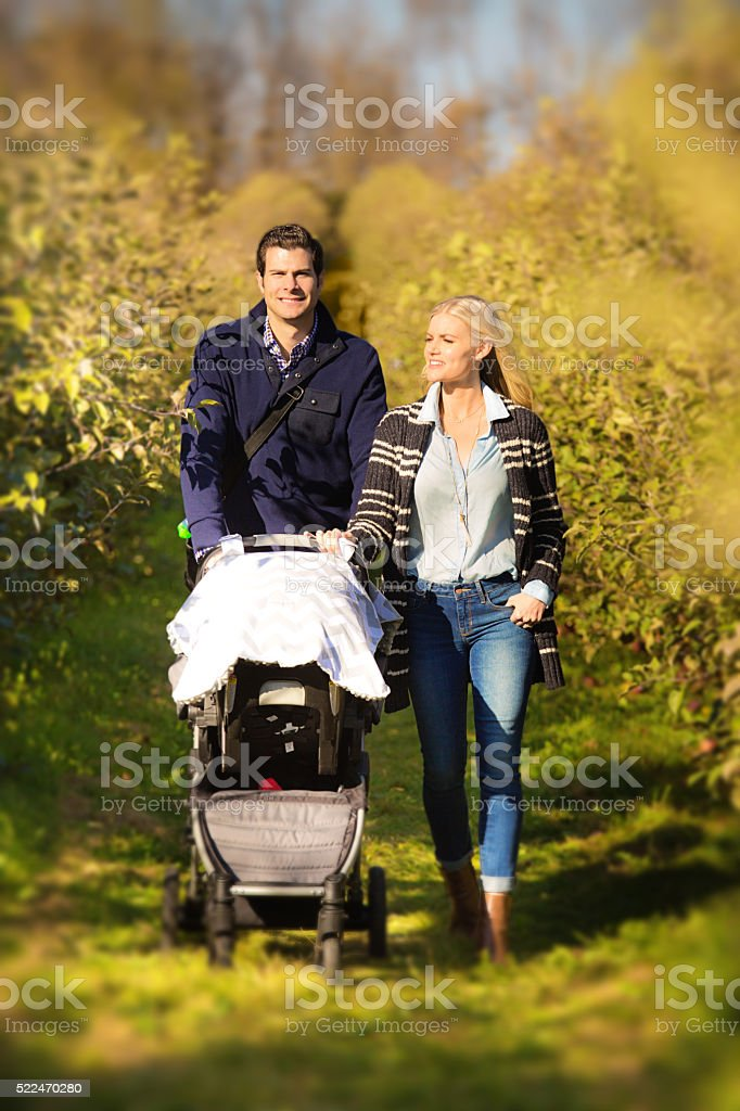 Young Caucasian Family Couple with Parents and Baby stock photo