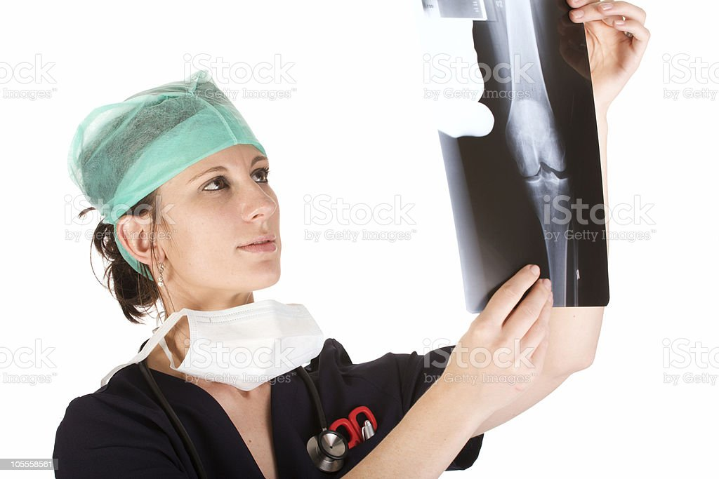 Young Caucasian female doctor examining an x-ray stock photo