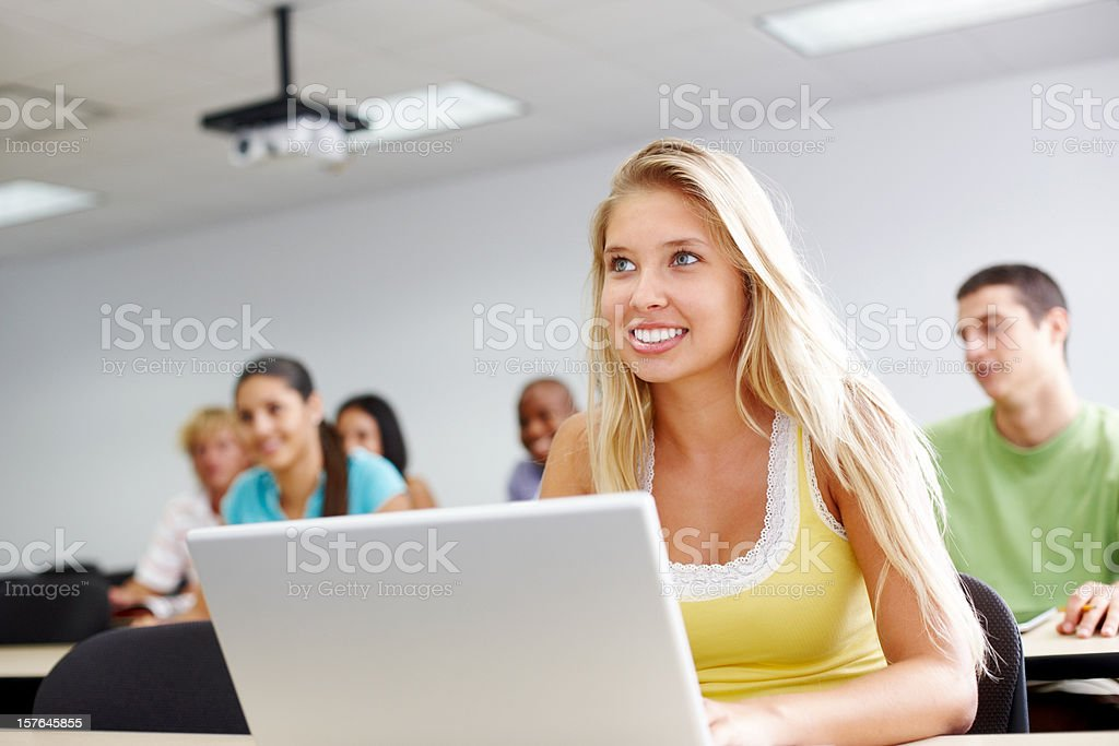 Young caucasian girl attending a lecture royalty-free stock photo