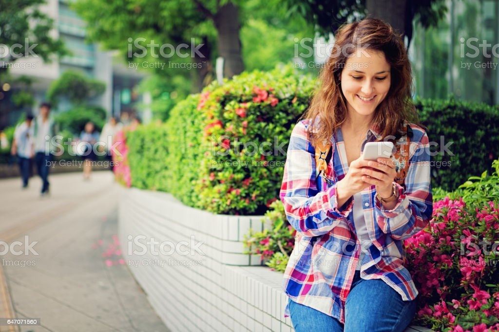 Young Caucasian girl is texting stock photo