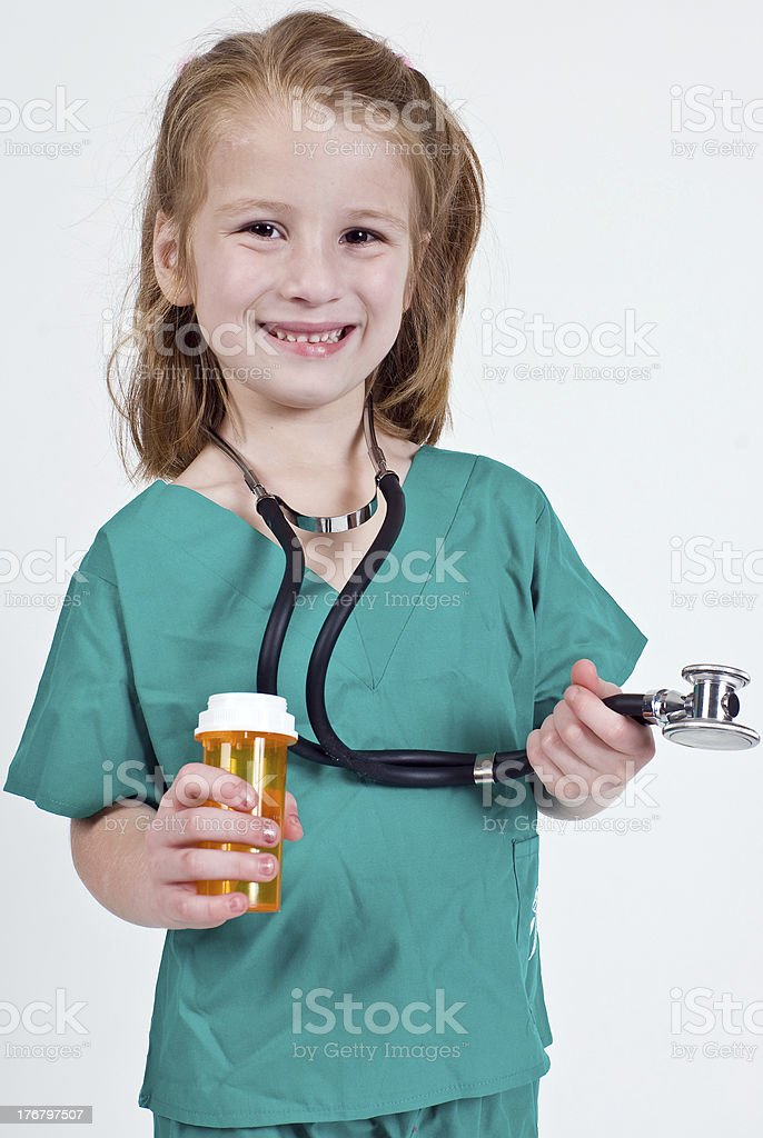Young caucasian girl playing doctor royalty-free stock photo