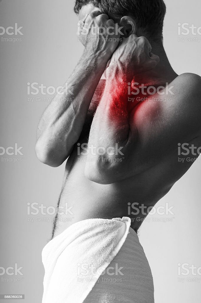Young Caucasian man blocking pain stock photo