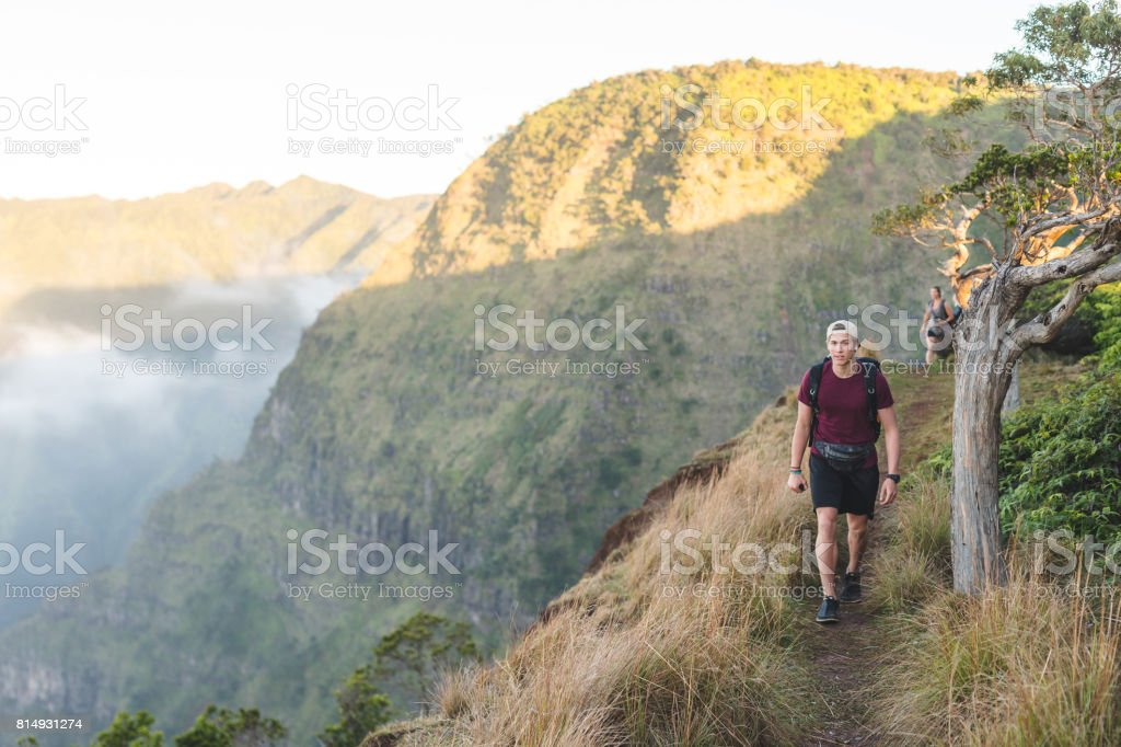 Young Caucasian man hiking in Hawaii mountains stock photo