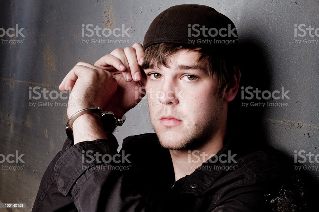 Young Caucasian Man In Handcuffs Under Arrest stock photo