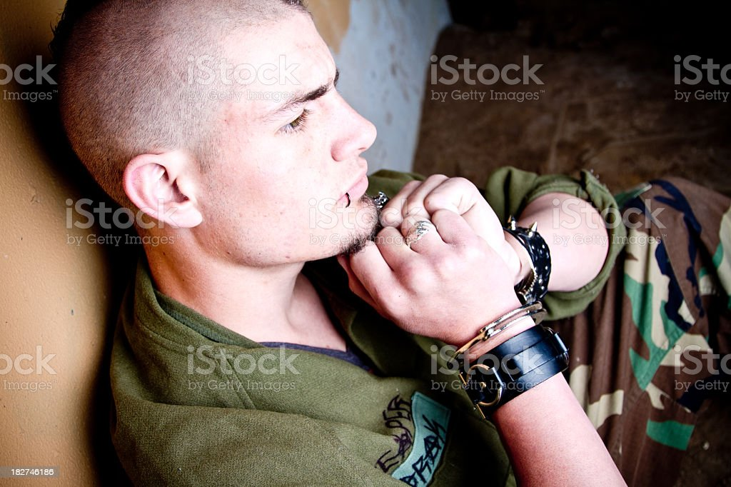 Young Caucasian Man In Handcuffs Under Arrest royalty-free stock photo