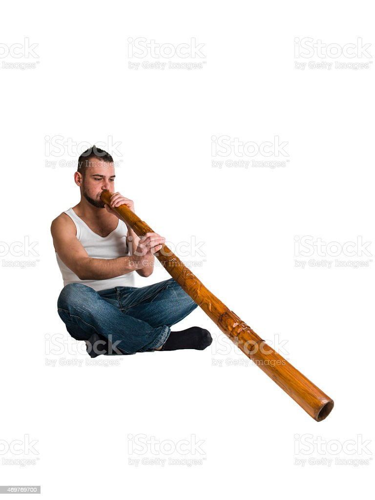 young caucasian man play music on his didgeridoo stock photo