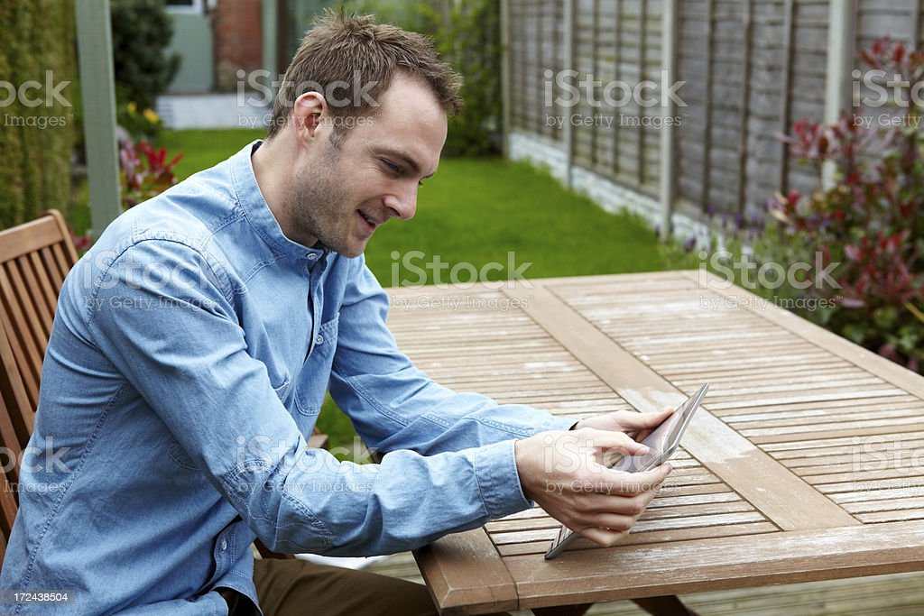 Young Caucasian man working on tablet computer royalty-free stock photo