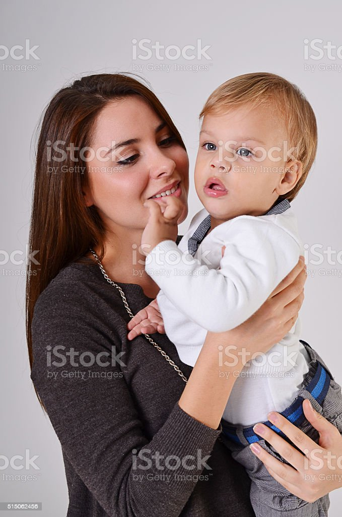 Young caucasian mother carrying baby boy stock photo