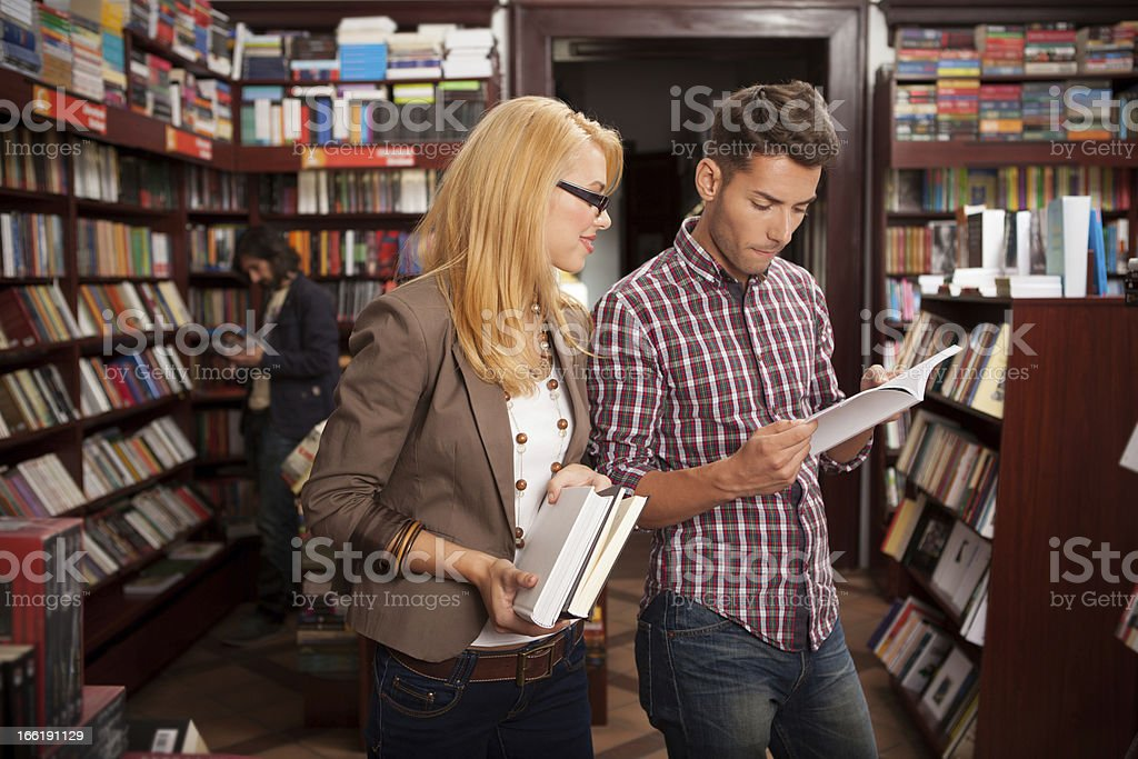 young caucasian people reading a book in  library stock photo