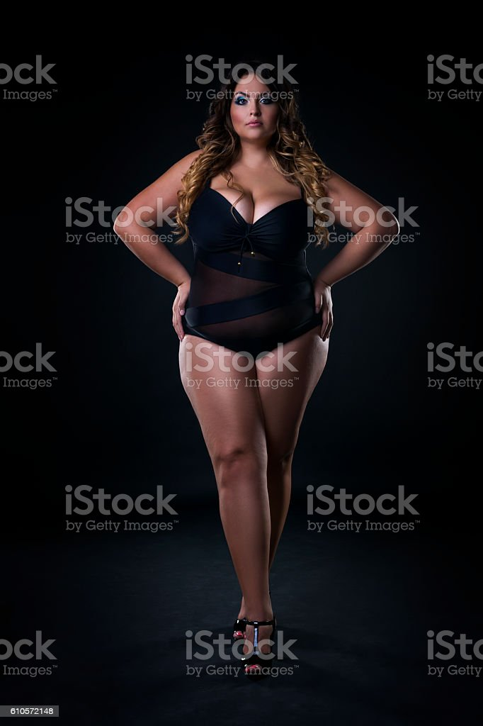 Young caucasian plus size model in swimsuit, xxl woman stock photo