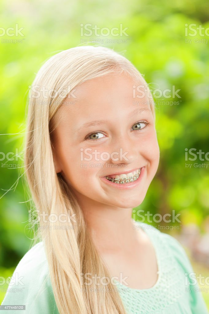 Young Caucasian Teen Girl Portrait with Dental Teeth Braces stock photo