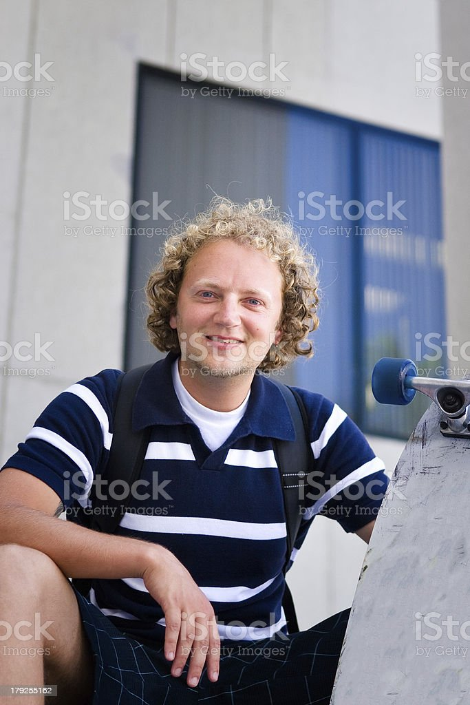 Young caucasian with skateboard royalty-free stock photo