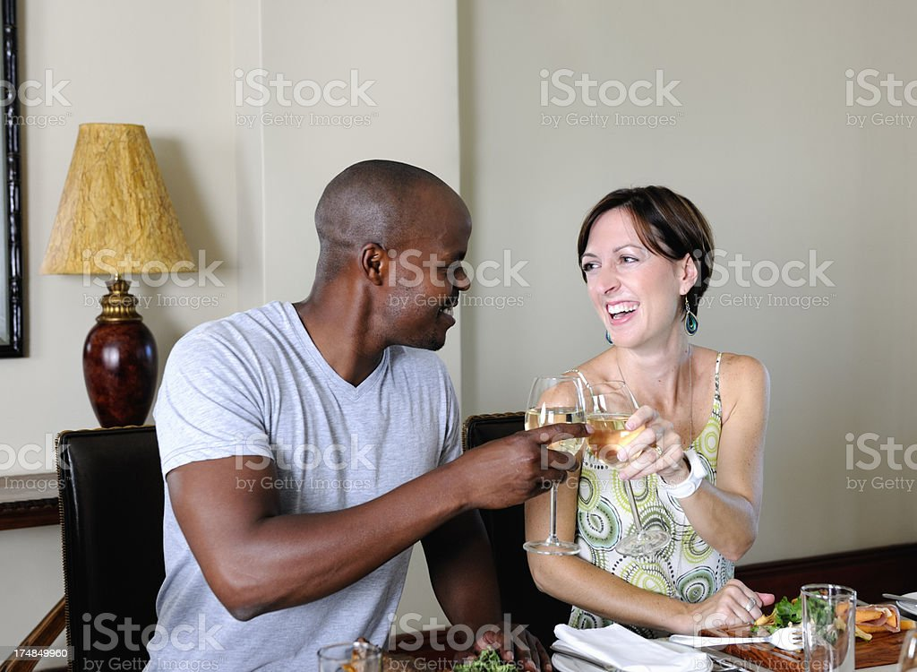 Young Caucasian Woman and Colored Man in Restaurant stock photo