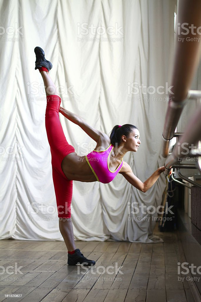 Young caucasian woman dancer in pink clothes royalty-free stock photo
